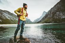 Man Backpacker Walking On Horseid Beach In Norway Travel Lifestyle Wanderlust Concept Adventure Outdoor Summer Vacations Wild Nature