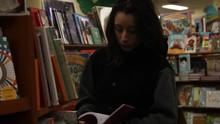 Transgender Teenager Flipping Through Book In Store
