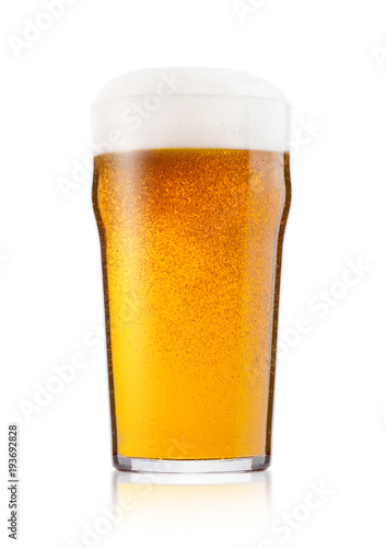 Canvas Print Cold glass of lager ale beer with foam and dew