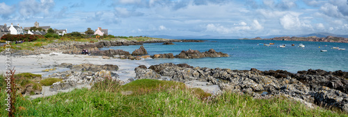Fototapeta A view of the beachfront and turquoise water on the Isle of Iona in Soctland