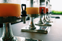 Selective Focus At Heart Valve Shape Of Juice Dispenser On The Table. / Concept Of Refreshment And Healthy