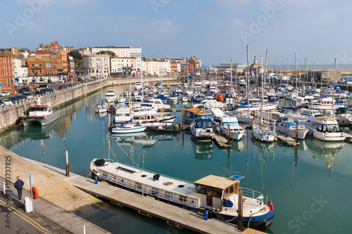 Tuinposter Schip The marina of the Royal Harbour of Ramsgate, Kent, UK. The town has one of the largest marinas on the English south coast. It was given its royal status by King George IV