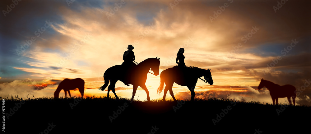 Fototapety, obrazy: couple on horseback at sunset