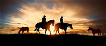 Couple On Horseback At Sunset