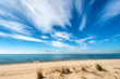 Seascape with dramatic blue sky and clouds