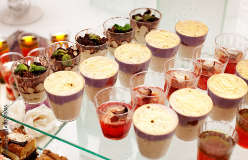 Assorted gourmet desserts on the glass. Concept party, wedding, restaurant, catering, dessert.