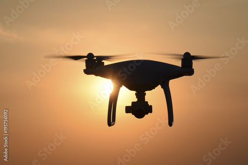 Quadrocopters silhouette against the background of the sunset Wallpaper Mural