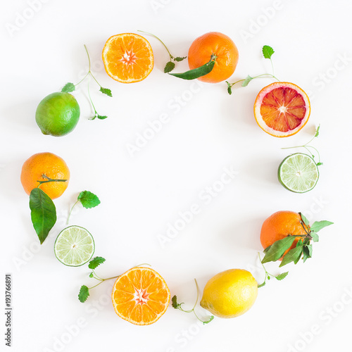 Fruit background. Colorful fresh fruits on white table. Orange, tangerine, lime, lemon, grapefruit. Flat lay, top view, copy space, square