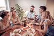 canvas print picture - Group of  friends enjoying meal at home together