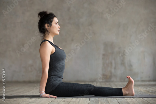 Cuadros en Lienzo Young sporty woman practicing yoga, doing Staff exercise, Dandasana pose, workin