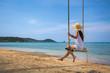 Woman on swing in beach