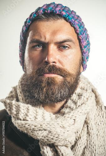 d5c5405adbd Confident bearded man wearing hat