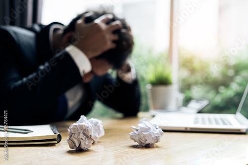 Fotografija  Businessman failure project plan deadline serious emotion and depression or dead
