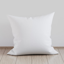Blank White Soft Square Pillow On A Wooden Floor Near The Wall, 3D Render