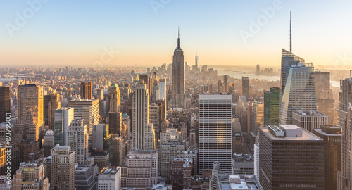 New York City. Manhattan downtown skyline with illuminated Empire State Building and skyscrapers at sunset. USA.