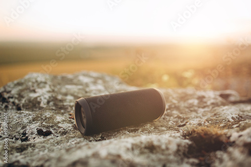 Сreative design portable wireless bluetooth speaker for music listening on sunset Wallpaper Mural