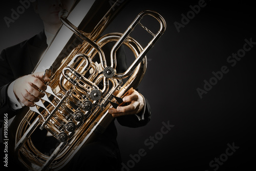 Photo sur Aluminium Musique Tuba brass instrument hands closeup