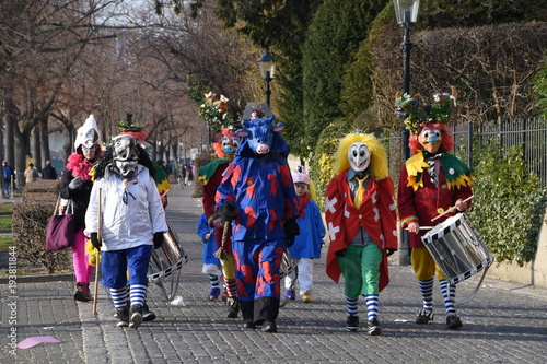Fotografie, Obraz  A colourful parade of carnival masks in the city of Basel, Switzerland, revives a centuries old tradition of masked and costumed performances