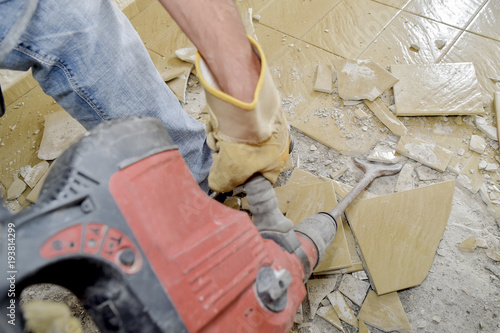 Removing Old Floor Tiles Buy This Stock Photo And Explore Similar