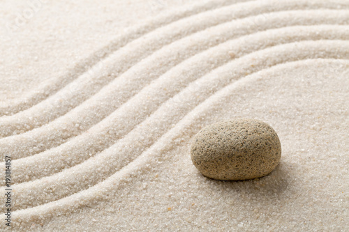 Fotobehang Stenen in het Zand Zen sand and stone garden with raked curved lines. Simplicity, concentration or calmness abstract concept