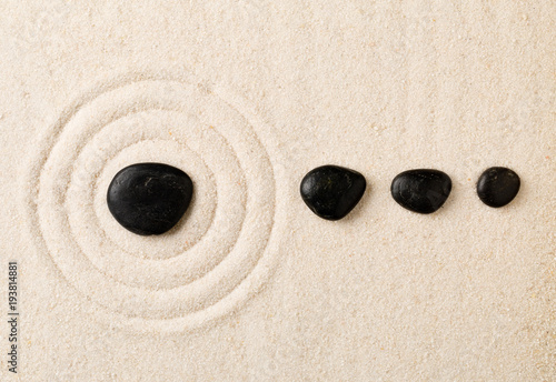 Poster Stones in Sand Zen sand and stone garden with raked circles. Simplicity, concentration or calmness abstract concept