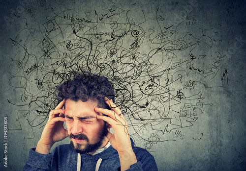 Thoughtful stressed man with a mess in his head Fototapeta