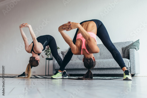 Photo Fitness women back stretching training at home