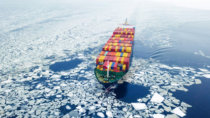 Aerial view of container ship in the sea at winter time
