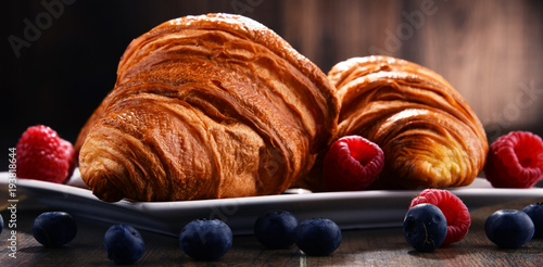 Fotografie, Obraz  Composition with croissants and fruits on the table