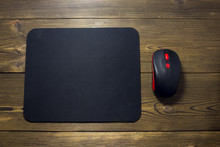 Computer Mouse Pad And Mouse On A Wooden Background