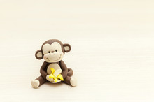 Little Monkey Toy Sitting With...