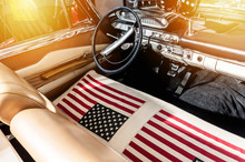 USA Flag On Seat Of A Car