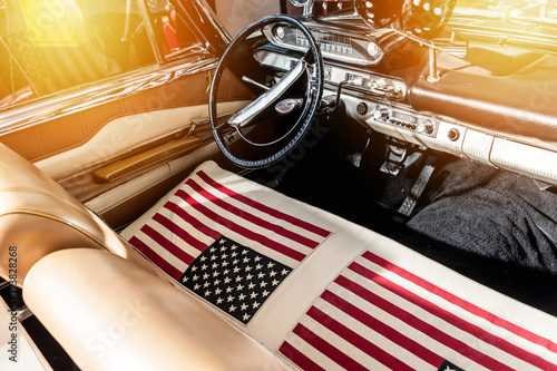Plakat USA flag on seat of a car