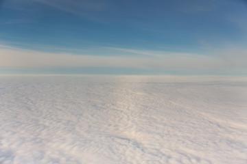 Fototapeta na wymiar white fluffy clouds and blue sky