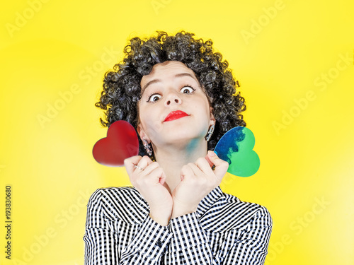 Portrait Of A Young Girl With Afro Hair With Glass Heart Shape On A