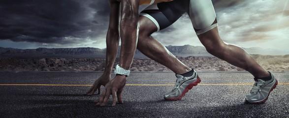Sports background. Runner feet running on road closeup on shoe. Start line
