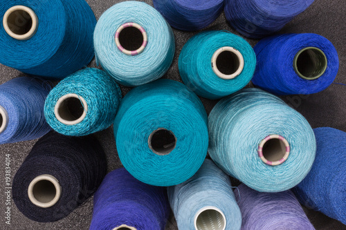 Photo cones of wool and cotton yarn in turquois, blue and green