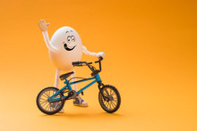 Funny Egg With Miniature Bicycle