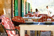 Outdoor cafe, table set for a luncho on sunny warm day. Mediterran city or town
