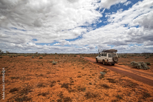 Foto op Canvas Australië South Australia – Outback desert with 4WD track under cloudy sky as panorama