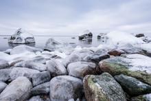Rocky Beach On Wintertime. Eve...