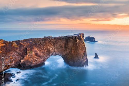 Fotografie, Obraz  Dyrholaey rock formation at sunset