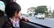 baby boy looking out of window car driving road trips travel