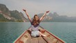 Happy woman traveler relaxing on boat her arms open feeling freedom, Andaman sea, Surin island, Phangnga,Travel in Thailand, Beautiful destination Asia, Summer holiday outdoors vacation trip