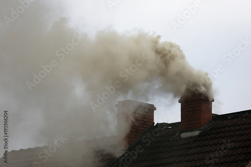 Fotografie, Obraz  Brown smoke from chimney house due to combustion of coal