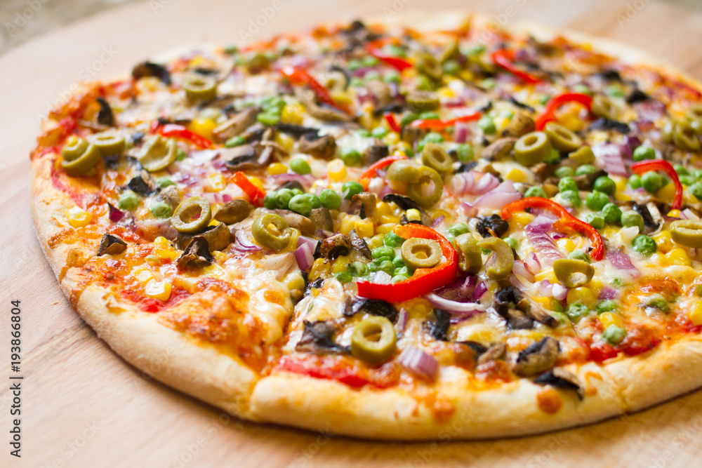delicious vegetarian pizza on wood