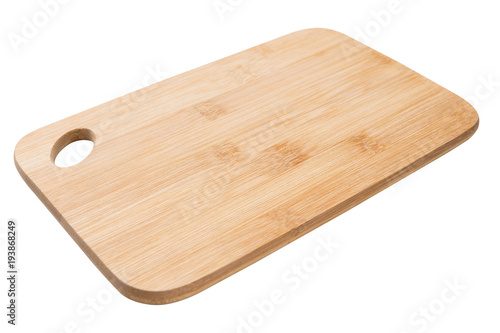 Foto  wooden cutting board on white background, side view