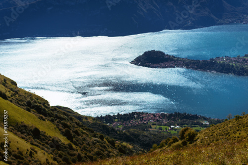 Foto op Plexiglas Nachtblauw Panoramic View of beautiful landscape in the Italian Alps with fresh green meadows and snow-capped mountain tops in the background on a sunny day with blue sky and clouds in springtime.