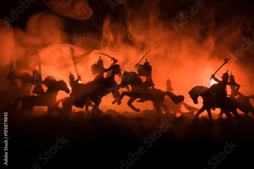 Fotografering Medieval battle scene with cavalry and infantry