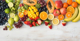 Fototapeta Tęcza - Assortment of fresh fruits and vegetables in rainbow colours on the off white table, top view, selective focus
